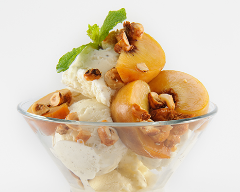 Makers mark ice cream topped with poached peaches and hazelnut crunch 494x396
